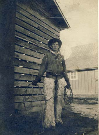 Cowboy in chaps and holding rope postcard, 1900s