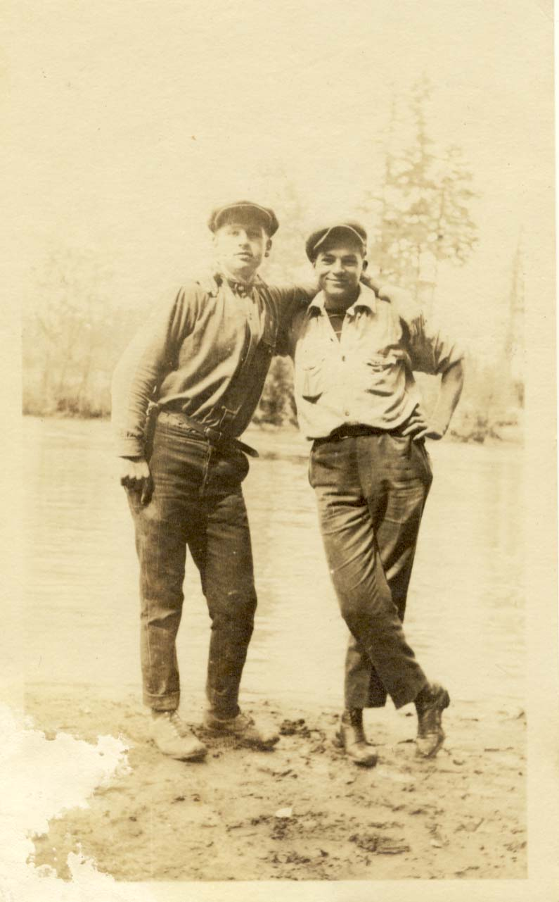 2 men with arms on the shoulders of the other photograph