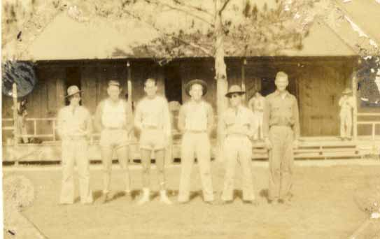 Six unidentified men, two in shorts photograph 1933
