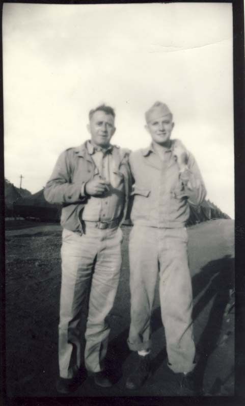 Fourth Marine Division, two men photograph