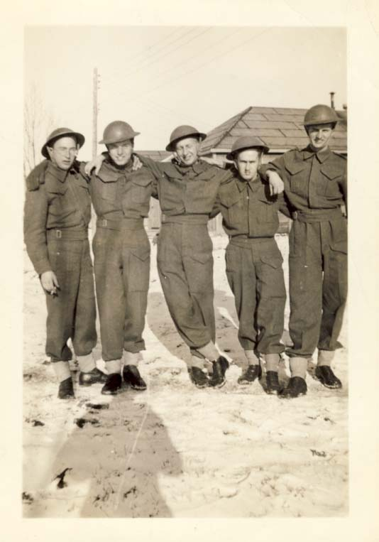 Group of five military men standing in the snow photograph