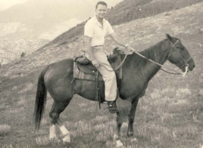 Another horseman, on his horse photograph