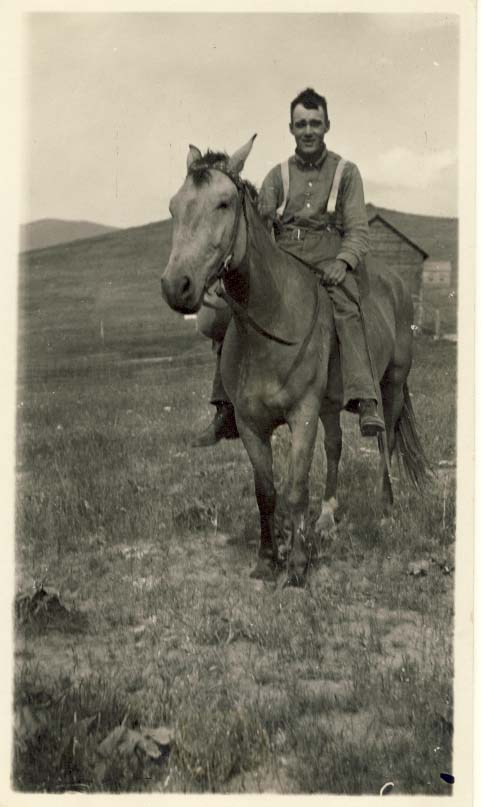 Man wearing suspenders, without hat, on his horse postcard